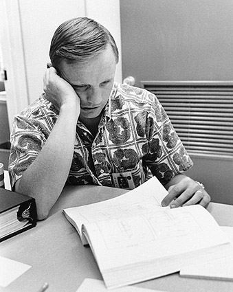 Neil Armstrong Reviewing Flight Plans Photo Print