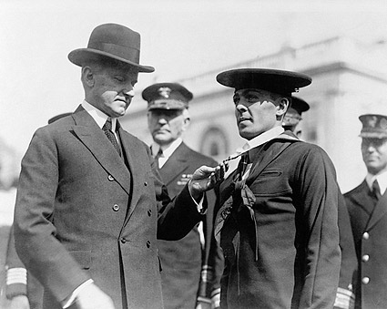 President Coolidge Decorating Sailor with Medal Photo Print