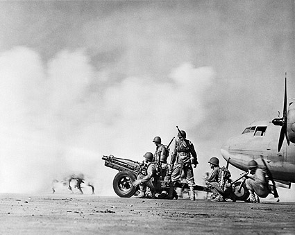 Soldiers Shooting Cannon from Airstrip WWII Photo Print
