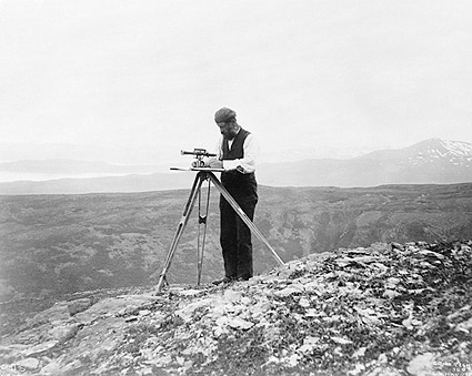Surveyor Using Theodolite in Alaska Photo Print