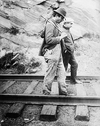 Traveling Hikers Tramp on a Railroad Track Photo Print