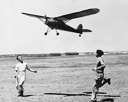 Two Boys Flying a Giant Model Airplane FSA Photo Print