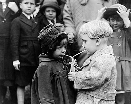 Young Boy and Girl Sharing a Sip 1922 Photo Print