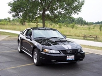 2004 Mustang GT in black with Gun Metal racing stripes- Jim Artos '04