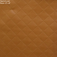 """Gatsby - Amber"" Embossed Faux Leather Vinyl with Quilted Pattern from Arc-Com Fabrics, Inc"