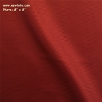 """Linette - Red Dot"" Solid Textured Polyurethane Fabric from Anzea Textiles"