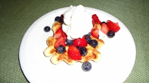 Mandarin Orange Waffles with Fresh Berries & Grand Marinier Whip Cream