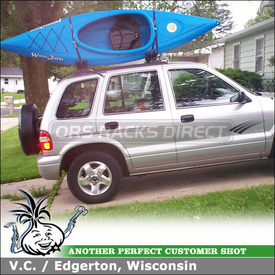 2001 Kia Sportage Roof Kayak Rack using Thule 835XTR Hull-a-Port on Factory Rack Cross Bars