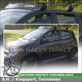 2006 Scion xA with Locking Rooftop Rack System and Wind Deflector