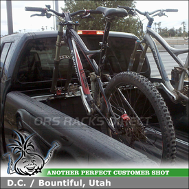2008 Nissan Frontier Crew Cab Truck Bike Racks using RockyMounts Clutch SD & Yakima 25MM / 15MM Thru-Axle Adapters