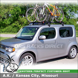 "2009 Nissan Cube Bike Roof Rack using Yakima Q Towers, Q31 Clips, 50"" Fairing & Raptor Bike Racks"