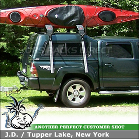 2009 Toyota Tacoma ARE Camper Shell Roof Kayak Racks using Thule 430 Tracker II & TK1 Kit, Malone AutoLoaders & Telos Kayak Lift-Assist