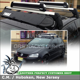 2009 VW GTI with Locking Ski and Snowboard Holder and Wind Fairing on Factory Car Rack