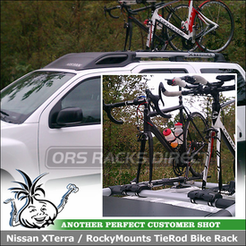 2011 Nissan XTerra with Fork Mounted Bike Carriers on a Factory Car Rack