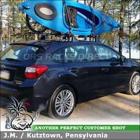 2012 Subaru Impreza Factory-OEM Roof Rack Cross Bars with Inno INA450 Kayak Rack and INA381 Fork Lock Attached