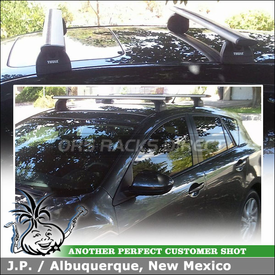 Aerodynamic Thule Cross Bars Rooftop Rack for Preset Points on a 2012 Mazda 3