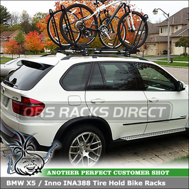 BMW X5 with Two Upright Bike Mounts on a Factory Cartop Rack