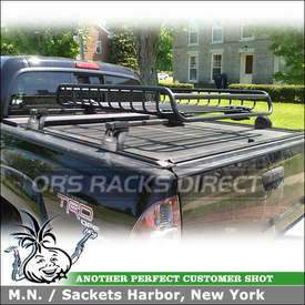 Cargo Gear Basket Mounted to 2011 Toyota Tacoma Tonneau Cover Rack Crossbars using Thule TB60 Tracks, 460 Podium w/ 3101 Fit Kit and Yakima LoadWarrior Basket