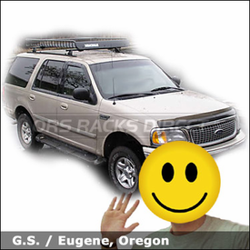 Ford Expedition with Yakima Control Towers Roof Rack and Yakima MegaWarrior Gear Basket