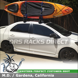 Kayak Roof Rack for 2007 Toyota Yaris 4-door using Inno INSU (w/ INSU Stays, K297 Fit Hooks & B117 Crossbars), INA261 Fairing and Thule 834 Hull-A-Port