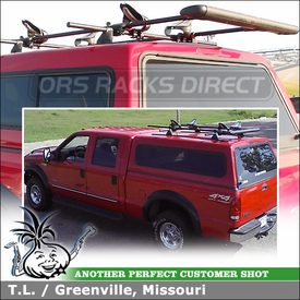 "Kayak Saddles & Boat Roller Mounted to Roof Rack Crossbars on 2000 Ford F250 Camper Shell Roof Tracks using Yakima 60"" Tracks, Control Towers, Landing Pad 1, Mako Saddles & ShowBoat 66 Roller"