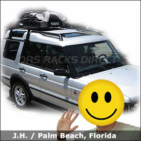 Land Rover Discovery with Thule 953 Super High Gutter Foot and Thule 630 Ranger 90 Roof Bag