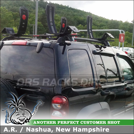 Malone MPG202 Universal Cross Rails and 2 AutoLoader Kayak Racks Installed On Jeep Liberty Factory Side Rails