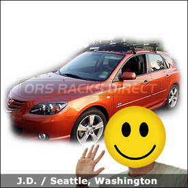 Mazda 3 5-door with Yakima Q Towers Roof Rack, Fairing and Yakima Copperhead Bike Racks