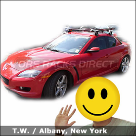 Mazda RX 8 with Yakima Q Towers Roof Rack and Yakima Copperhead Bike Rack