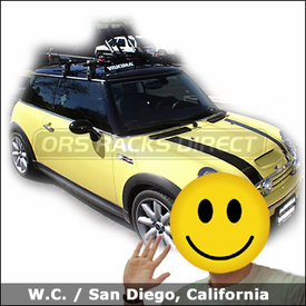 Mini Cooper with Yakima Q Towers Roof Rack, Fairing, Yakima SteelHead Bike Racks and Spare Wheel Holders