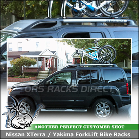 Nissan XTerra with Two Factory Rack Compatible Rooftop Bike Trays
