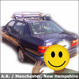Volkswagen Jetta Roof Rack for Skis & Snowboards with Thule 400XT Base System and Thule 725 Flat Top Ski Rack