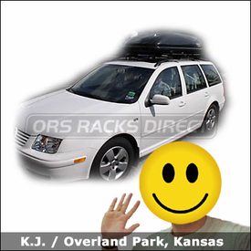 Volkswagen Jetta wagon with Thule 450 Crossroad Car Rack and Thule 677XT Cascade 1500 Roof Box