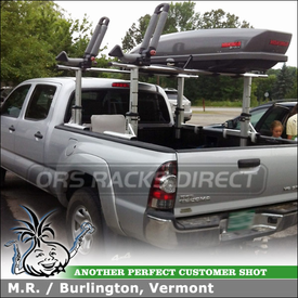 Yakima BowDown Kayak Cradles and Yakima SkyBox Pro 12 Cargo Box Mounted to Thule 422XT Xsporter Ladder Rack In Toyota Tacoma Pickup Truck Bed