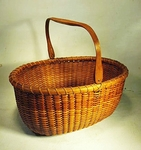 Antique oval Nantucket Lightship basket circa 1922