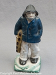 Vintage Old Salt Doorstop with Blue Coat