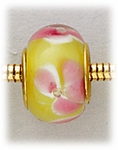 Add A Bead Gold yellow with large pink flowers glass