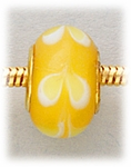 Add A Bead Gold yellow with white swirls glass
