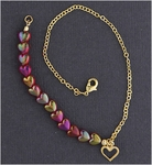 Anklet gold and ruby heart beads with open heart drop