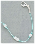 Anklet turquoise cord knotted with pearl accents