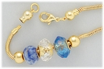 bracelet add a bead set gold 7 1/2 inch threaded end bracelet with two stopped beads and three blue beads