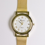 watch gold white face gold band