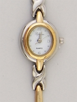 Watch two tone gold & silver oval white face two tone cross band