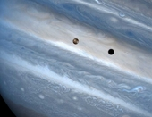 Io Sweeping Across Jupiter