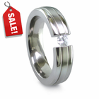 Contoured Titanium Ring with Tension Set Diamond by Edward Mirell