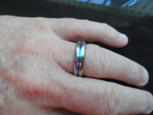 Titanium-jewelry.com customer wearing EDWARD MIRELL Titanium Ring with Rainbow Groove - 1