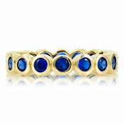 Joy's Goldtone Eternity Ring - Blue CZ