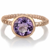 Suri's Bezel Set Simulated Amethyst Twisted Rose Gold Tone Ring
