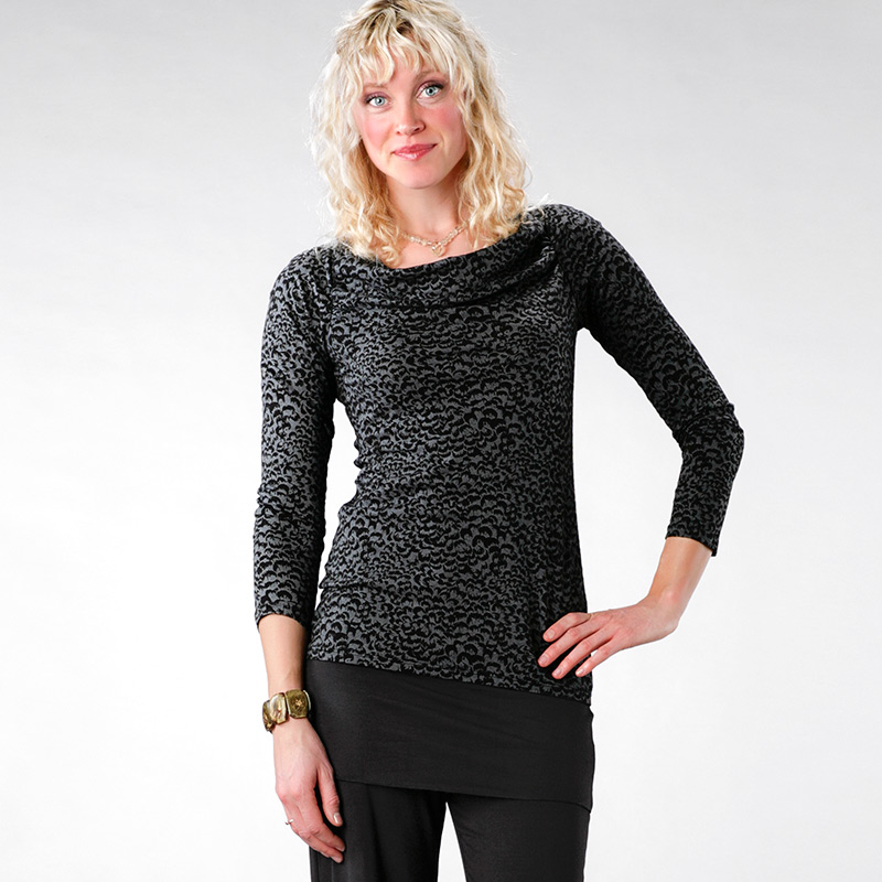 A Joah Brown best selling long sleeve top with dolman sleeves, fitted cuffs and ribbed accents. Feel a subtle pop of texture in this lightweight ribbed fabric. Stretchy .