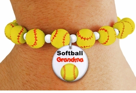 """<Br>                  EXCLUSIVELY OURS!!<Br>            AN ALLAN ROBIN DESIGN!!<Br>                 LEAD & NICKEL FREE!! <BR>W20626B - YELLOW STRETCH SOFTBALL <BR>   THEMED CHARM BRACELET WITH A<BR> """"SOFTBALL GRANDMA"""" SILVER TONE CHARM <BR>      FROM $6.19 TO $13.75 �2013"""